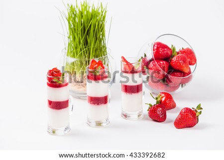 Strawberry Panna Cotta on a white background close - stock photo