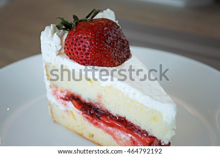 Strawberry short cake on white dish the delicious.