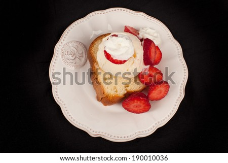Strawberry shortcake top view on a black background - stock photo