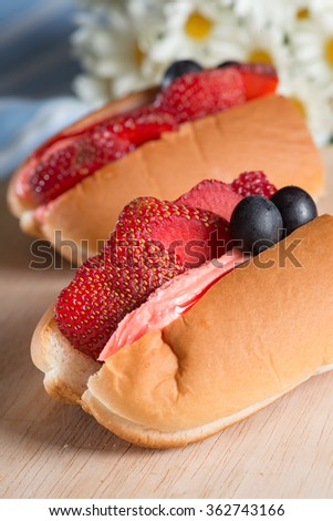 Strawberry slice with flavor cream filled hotdog bread. - stock photo