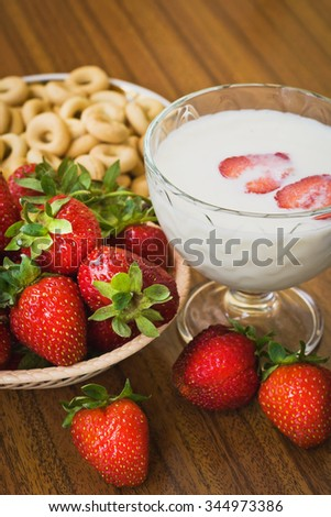 Strawberry smoothie in glass jar, over wood table. Selective focus