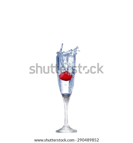 Strawberry splash in a cocktail glass on white - stock photo