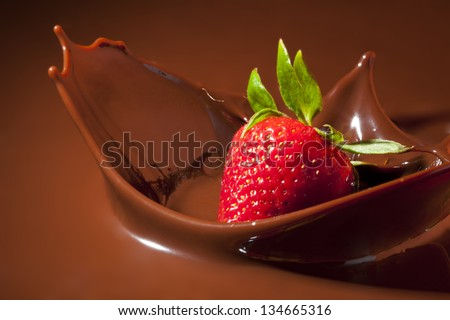 Strawberry Splashing in Milk Chocolate - stock photo