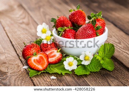 Strawberry. Strawberry on wood background. Red strawberries, strawberries . Strawberry with green leaves. Healthy strawberries. strawberry flower. - stock photo