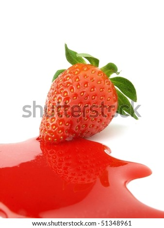 Strawberry syrup and fruit - stock photo