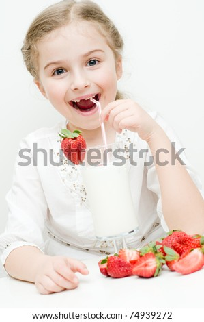 Strawberry time - little girl with milk and strawberry cocktail - stock photo
