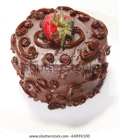 Strawberry topped chocolate sponge cake - stock photo