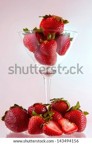 Strawberry with glass of cocktail.