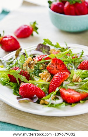 Strawberry with Walnut and Rocket salad by Balsamic dressing - stock photo