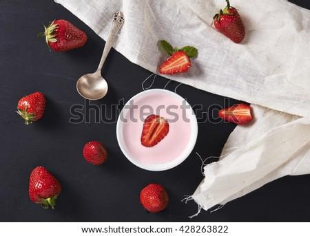 strawberry yoghurt and strawberries on dark background. top view - stock photo