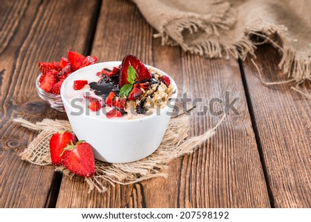 Strawberry Yogurt in a small bowl on wooden background - stock photo