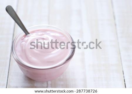 strawberry yogurt on wooden white background. strawberry yoghurt. pink yogurt. - stock photo