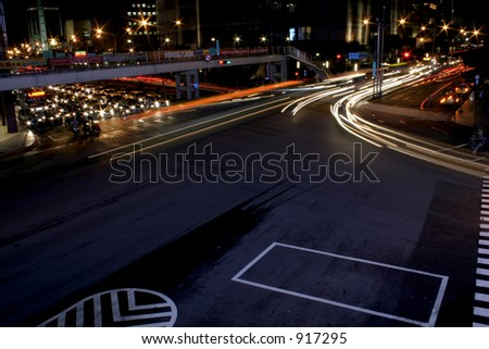 Streaking Lights on the Road - stock photo
