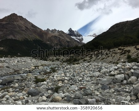 Stream and the Andes Mountains in Argentina - stock photo