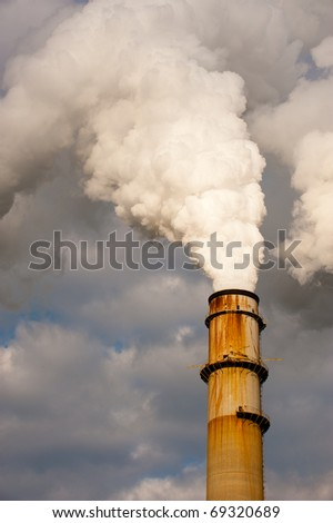 Stream billowing from electric power plant chimney stack
