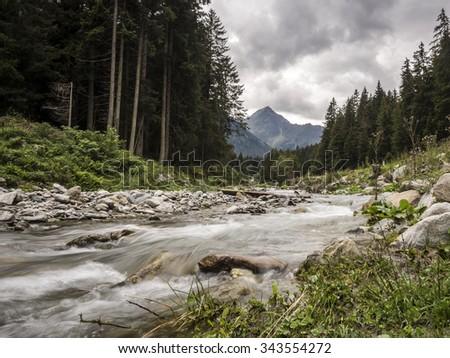 stream in the Austrian Alps - stock photo