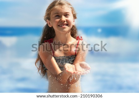Stream of clean water pouring into little girl hands. Little girl play with water. - stock photo
