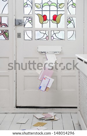 Stream of letters coming through the letter box - stock photo