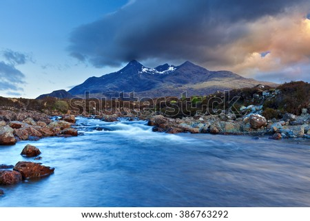 Stream of river flowing through rocks on Isle of Skye, Scotland. Picturesque landscape scene.