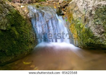 Stream on mountain brook - stock photo