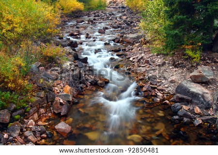 Stream ripples through the Lewis and Clark National Forest of Montana - stock photo