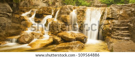 stream waterfall in the mountain - stock photo
