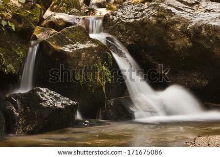 stream with fluent water, Stillensteinklamm, austria - stock photo