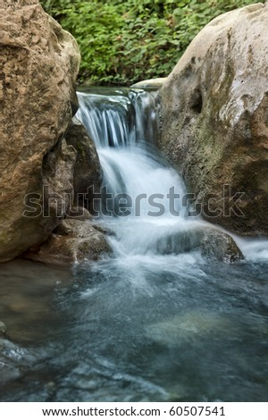 Stream with rocks in motin blur at Kziv river in the Galilee northen Israel - stock photo