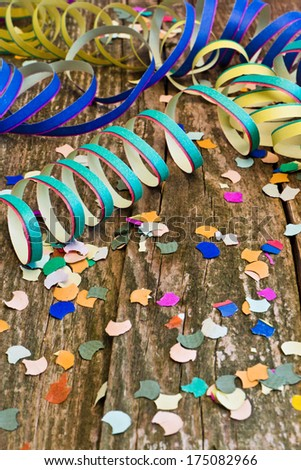 streamer, confetti on wood - stock photo