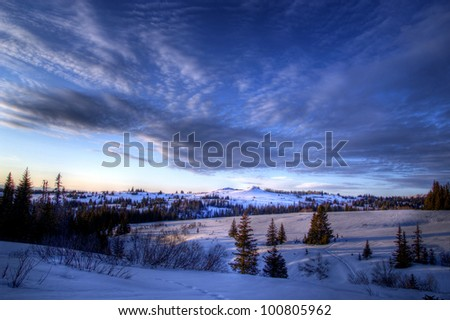 Streaming clouds in the evening sky in rural Alaska in winter.