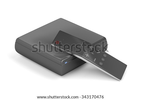 Streaming media player with remote control on white background - stock photo