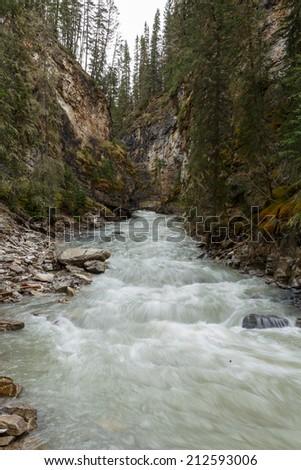 Streaming river at Johnston Canyon Canada - stock photo