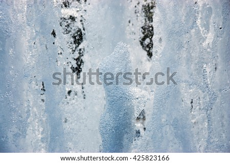 streams of transparent water from the fountain close up - stock photo