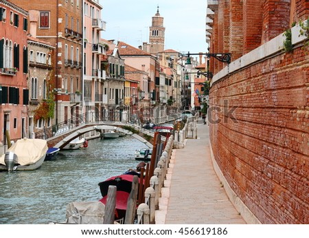 Street and canal, with a view of the bell tower, Venice Italy, September 27, 2015 - stock photo