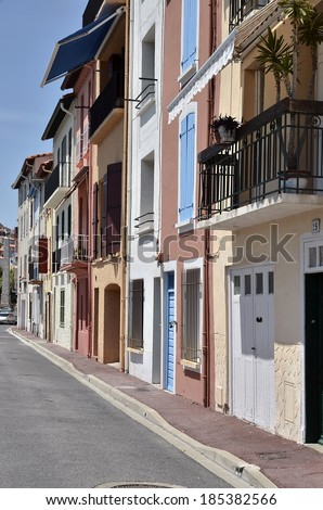 Street and facades of buildings of Port-Vendres, commune on the cote vermeille in the Pyrenees-Orientales department, Languedoc-Roussillon region, in southern France. - stock photo