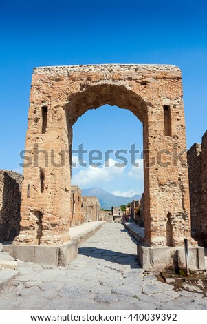 Street and gate in Pompeii, ancient roman city on the foot of Mount Vesuvius volcano