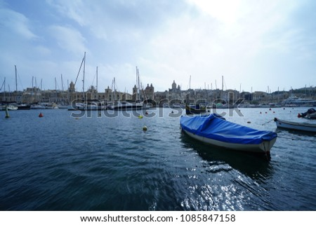https://thumb9.shutterstock.com/display_pic_with_logo/167494286/1085847158/stock-photo-street-and-townscape-in-malta-1085847158.jpg