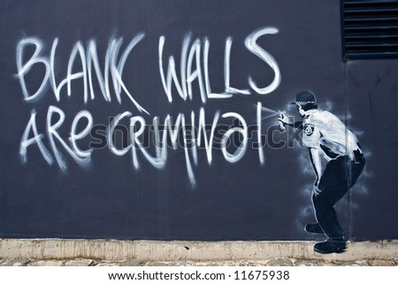 Street Art - Blank Walls are Criminal - stock photo