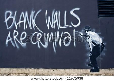 Street Art - Blank Walls are Criminal - stock photo