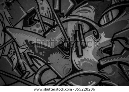 street art grafitti in black and white ink, segment of a dirty wall in the city - stock photo