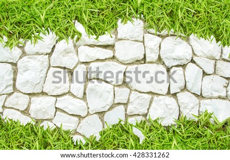 Street big rock wall  and grass on white stone pathway for background backdrop nature footpath, path, pathway, pavement, paving, sidewalk go green white and green nature background copy space for text - stock photo