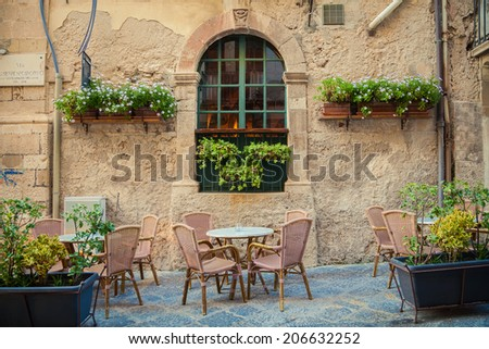 street cafe in old town of Siracusa city, Sicily, Italy - stock photo