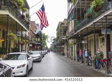 Street canyon in New Orleans French Quarter - NEW ORLEANS, LOUISIANA - APRIL 18, 2016  - stock photo