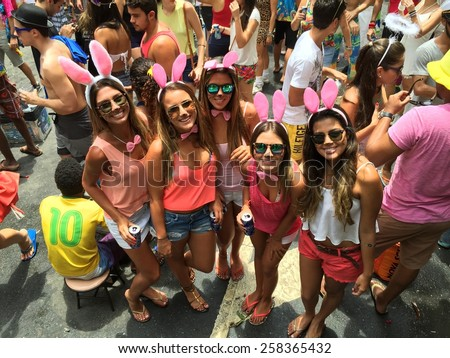 Street carnival parade in Rio de Janeiro, Brazil 2015 : Young women having party fun - stock photo