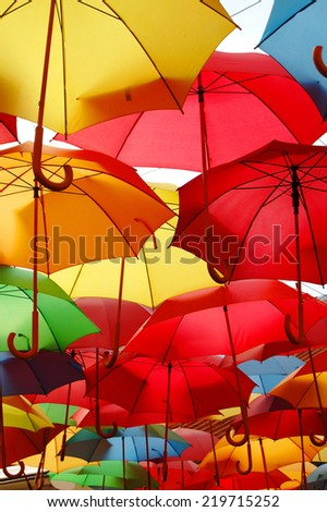 Street decorated with colored umbrellas - stock photo
