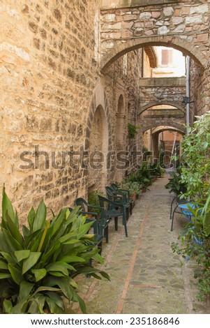Street decorated with plants in the historic Italian city. (Spello, Umbria, Italy.) - stock photo