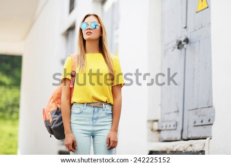 Street fashion concept - bright hipster girl in sunglasses outdoors posing in the city  - stock photo
