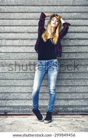 Street fashion portrait of sexy young woman - stock photo