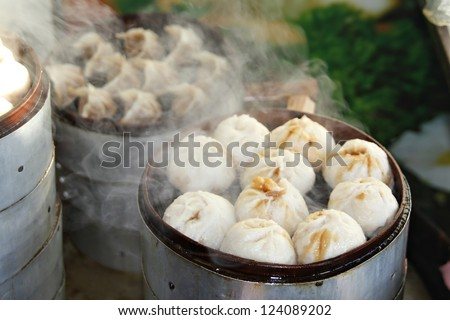 Street food booth selling Chinese specialty Steamed Dumplings in Beijing, China - stock photo