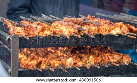 Street Food. Meat On Skewers Cooking Over Charcoal Grill - stock photo